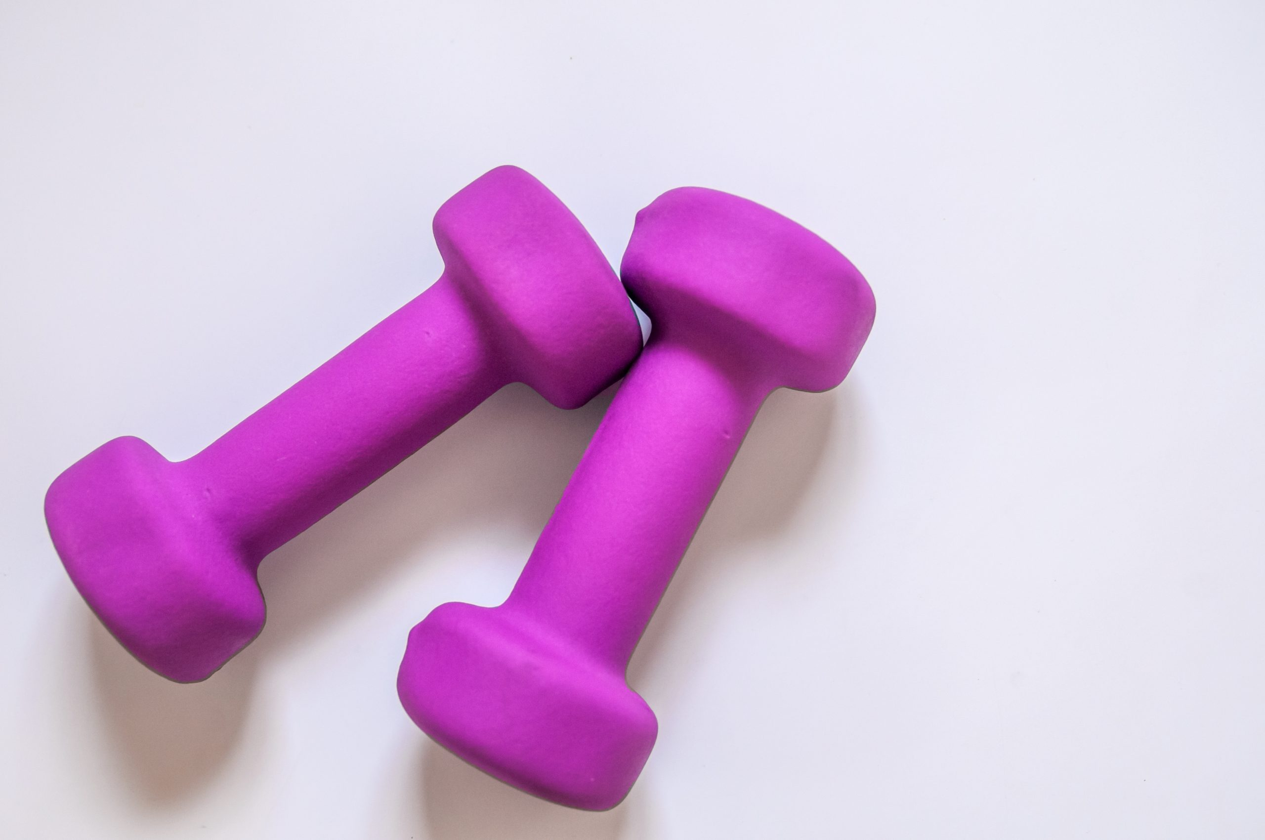 Purple dumbbells, fitness concept isolated on white background,
